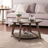 The Gray Barn Oriaga Round Cocktail Table w/ Glass Top - Burnt Oak