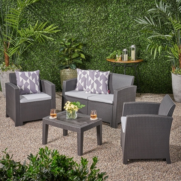 Daytona Outdoor 4-piece Wicker-style Chat Set with Cushion by Christopher Knight Home. Opens flyout.