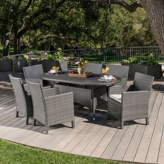 Cypress Outdoor 7-piece Oval Wicker Dining Set with Cushions by Christopher Knight Home|https://ak1.ostkcdn.com/images/products/18122706/P24276654.jpg?impolicy=medium