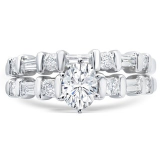 LeZari & Co. 1.00ct TDW Bridal Set with 0.65ct Oval Center, Round & Baguettes Accent with matching band in Fine White 14K Gold.