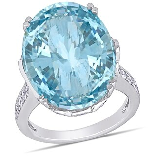 Miadora Signature Collection 14k White Gold Oval-Cut Sky-Blue Topaz and 7/8ct TDW Diamond Cocktail Ring