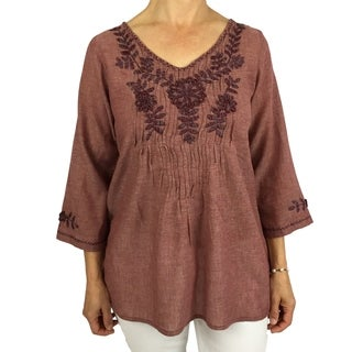 Handmade cotton blouse with floral hand-embroidered details. Produced by traditional artisans in Oaxaca, Mexico. Fairly traded.