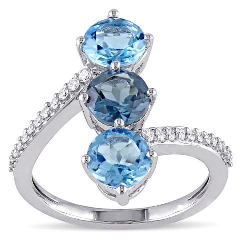 Miadora 14k White Gold Blue Topaz and 1/6ct TDW Diamond Bypass Ring (G-H, SI1-SI2)