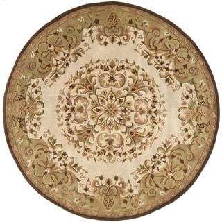 Safavieh Handmade Heritage Timeless Traditional Beige Wool Rug (6' Round)