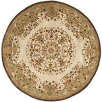 Safavieh Handmade Heritage Timeless Traditional Beige Wool Rug - 6' Round