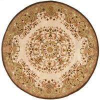 Safavieh Handmade Heritage Timeless Traditional Beige Wool Rug - 8' Round