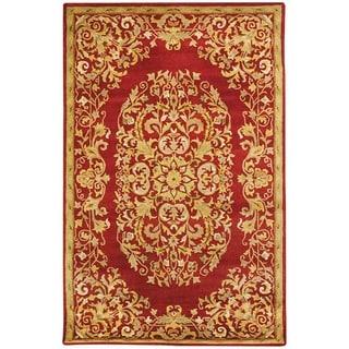 Safavieh Handmade Heritage Timeless Traditional Red Wool Rug - 7'6 x 9'6