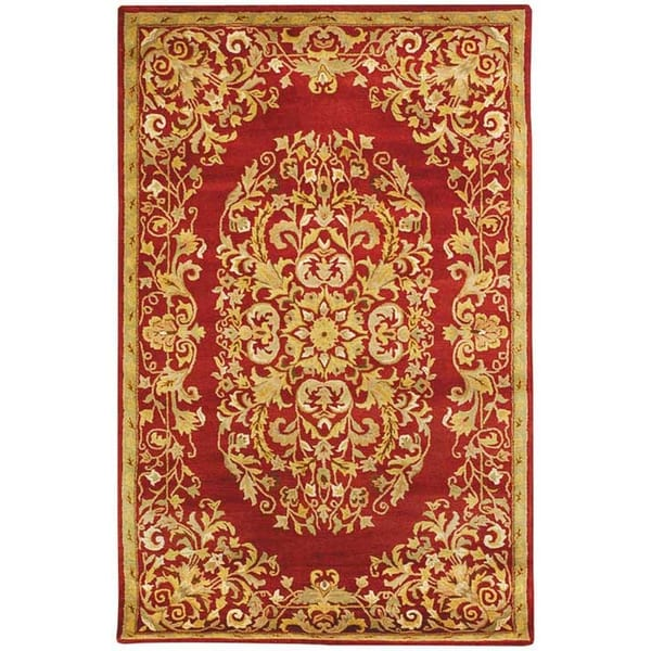 Safavieh Handmade Heritage Timeless Traditional Red Wool Rug - 7'6 x 9'6