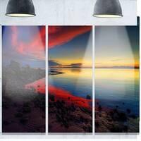 Designart 'Blasts of Color at the Sunset' Seashore Art Glossy Metal Wall Art
