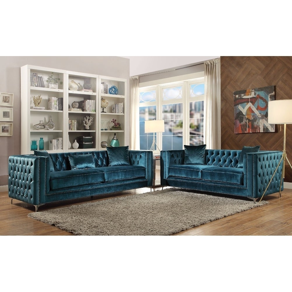 teal colored couches