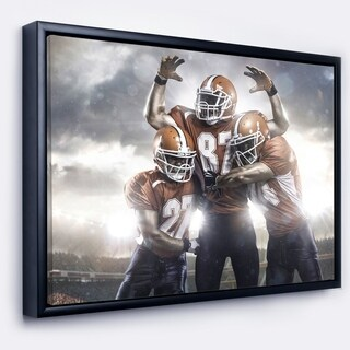 Designart 'American Footballer in Action' Sport Framed Canvas Art Print