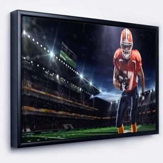 Designart 'American Footballer in Action on Stadium' Sport Framed Canvas Art Print
