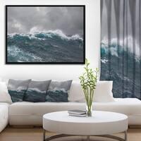 Designart 'Roaring Waves under Cloudy Sky' Seascape Framed Canvas Art Print