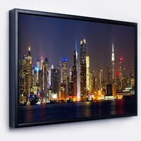 Designart 'New York Skyline at Night' Cityscape Photo Framed Canvas Print