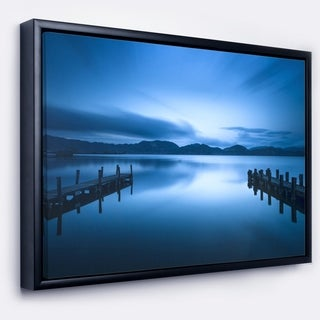Designart 'Dark Blue Sea and Piers' Seascape Framed Canvas Art Print