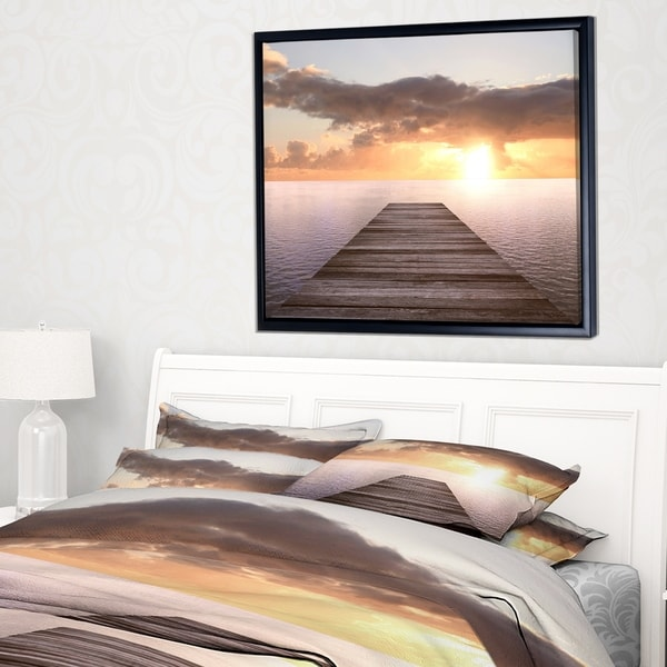 Designart 'Yellow Sea and Brown Pier' Seascape Framed Canvas Art Print