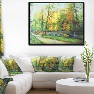 Designart 'Bridge in Colorful Forest' Landscape Painting Framed Canvas Print
