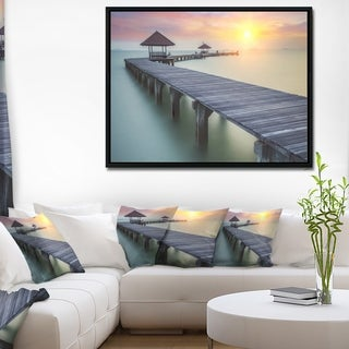 Designart 'Wooden Sea Bridge and Sunset' Seashore Photo Framed Canvas Print
