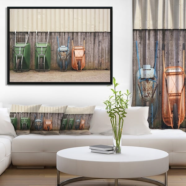 Designart 'Row of Wheelbarrows' Landscape Photo Framed Canvas Art Print