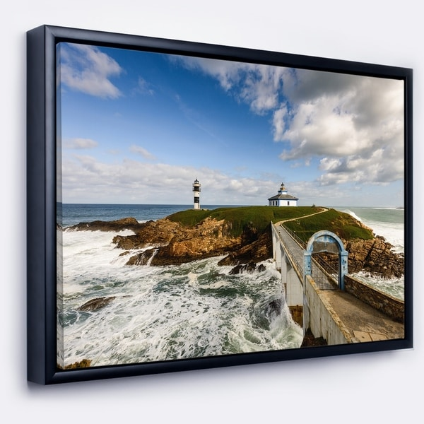 Designart 'Bright Illa Pancha Lighthouse' Seashore Photo Framed Canvas Print