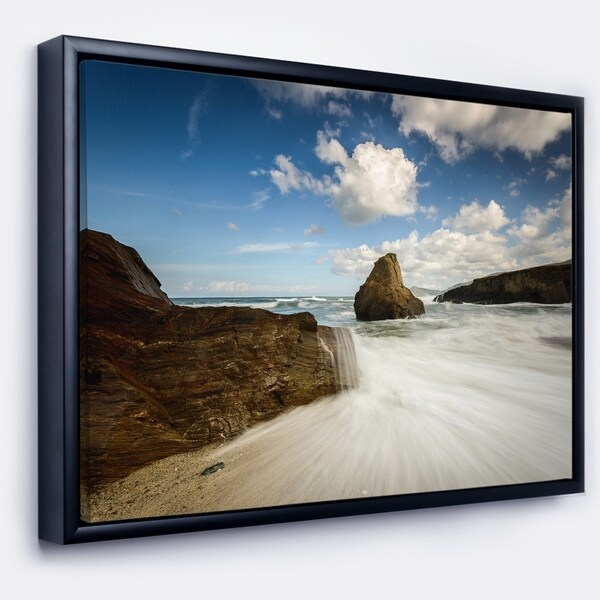 Designart 'Rushing Waters into Rocky Mountains' Seashore Photo Framed Canvas Print