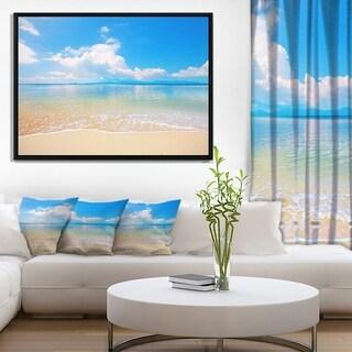 Designart 'Large Clouds Over Calm Beach' Seashore Photo Framed Canvas Print