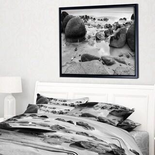Designart 'Moeraki Boulders Black n White' Seashore Photo Framed Canvas Print