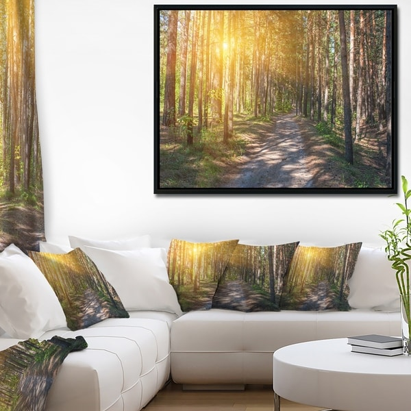 Designart 'Thick Forest with Yellow Sun Rays' Landscape Photography Framed Canvas Print