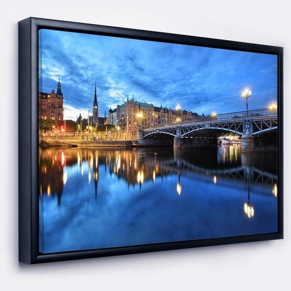Designart 'Illuminated Blue Stockholm' Cityscape Framed Canvas Print