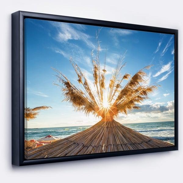 Designart 'Vivid Sunrise on Sandy Beach' Seascape Framed Canvas Art Print