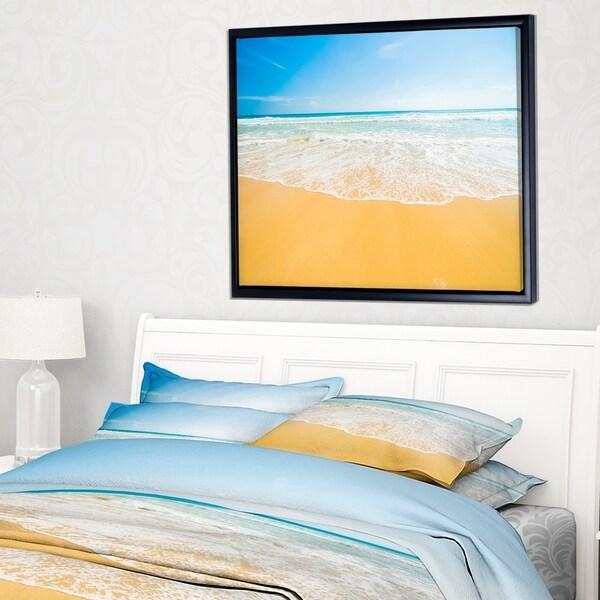 Designart 'Long Waves on Sand under Blue Sky' Seascape Framed Canvas Art Print