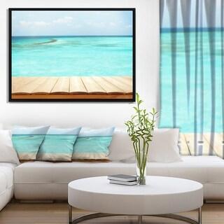Designart 'Wooden Planks on Sea Background' Seascape Framed Canvas Art Print