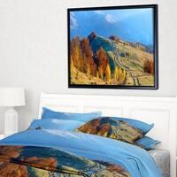 Designart 'Rural Road on Autumn Mountains' Landscape Framed Canvas Art Print