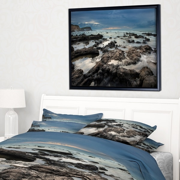 Designart 'Rocky Seashore with Blue Sky Over' Large Seashore Framed Canvas Print