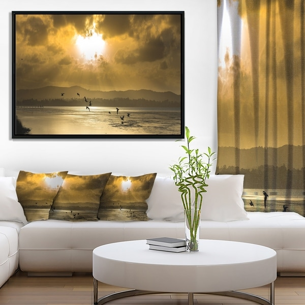 Designart 'Glittering Sun Among heavy Clouds' Large Seashore Framed Canvas Print