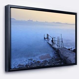 Designart 'Abandoned Pier into Blue Sea' Sea Bridge Framed Canvas Art Print