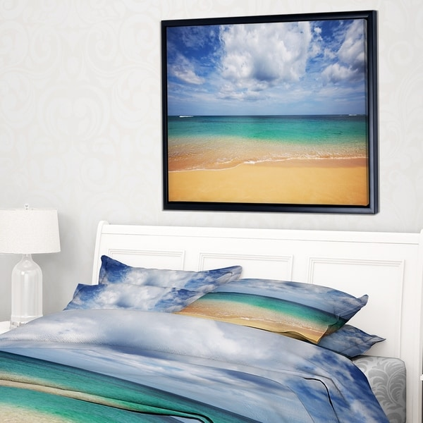 Designart 'Bright Seashore with Heavy Clouds' Modern Beach Framed Canvas Art Print