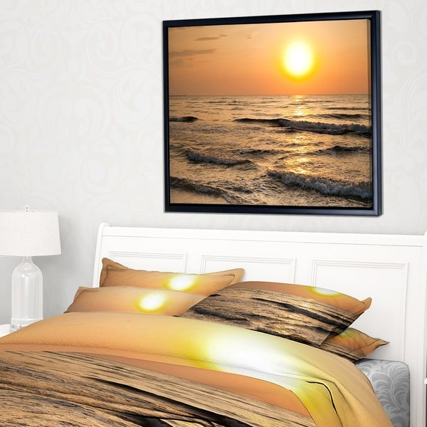 Designart 'Typical Sunrise with Tranquil Waves' Seascape Framed Canvas Art Print