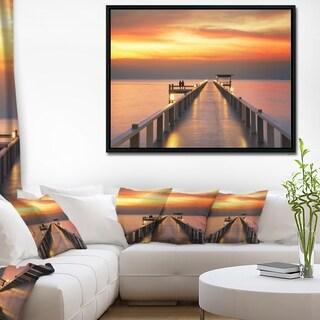 Designart 'Yellowish Sky and Long Wooden Bridge' Pier Seascape Framed Canvas Art Print