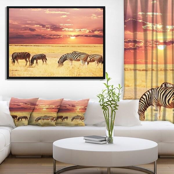 Designart 'Zebras Grazing Together at Sunset' Modern Landscape Wall Art Framed Canvas