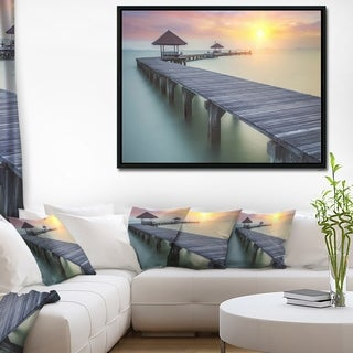 Designart 'Long Wooden Bridge into the Sunrise' Pier Seascape Framed Canvas Art Print