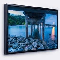 Designart 'Under Wood Bridge at Twilight' Sea Bridge Framed Canvas Art Print