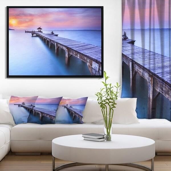 Designart 'Purple Seas and Long Wooden Pier' Pier Seascape Framed Canvas Art Print