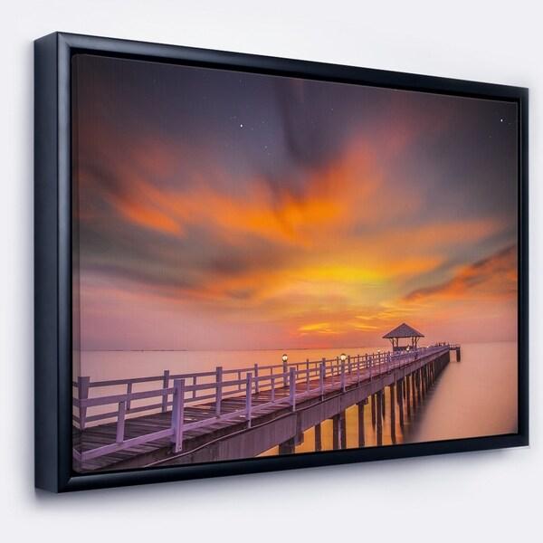 Designart 'Seashore with Long Wooden Pier' Pier Seascape Framed Canvas Art Print