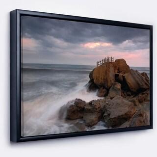 Designart 'The Fantasy Island with Large Rocks' Seashore Framed Canvas Art Print