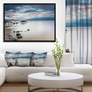Designart 'Magic Sunrise with Old Wooden Pier' Pier Seascape Framed Canvas Art Print