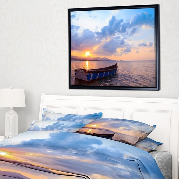 Designart 'Small Fishermen Boat at Sunset' Modern Seashore Framed Canvas Art
