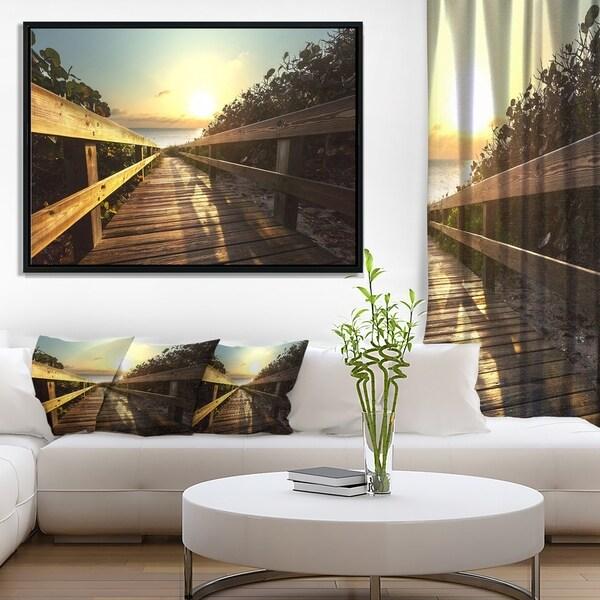 Designart 'Wood Boardwalk into the Sunset Sea' Bridge Framed Canvas Art Print