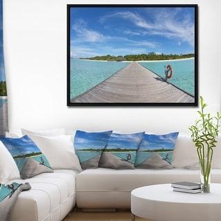 Designart 'Wooden Pier at Tropical Beach' Wooden Sea Bridge Framed Canvas Wall Art