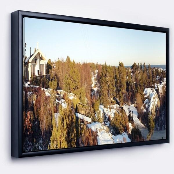 Designart 'Rocky Coast with Wooden Cottage' Landscape Framed Canvas Art Print